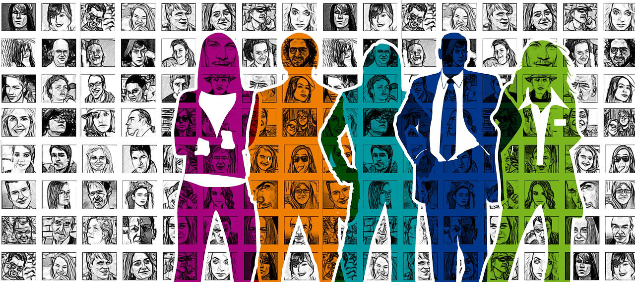 stylized silhouette of people standing in-front of a wall with images if diverse groups of people hanging on it